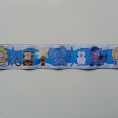 0,59 mètre de  ruban blanc et bleu motif animaux lion,singe, elephant, pingouin, zebre 35mm de largeur