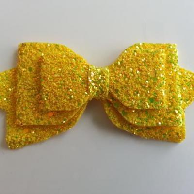 gros noeud pailleté en simili 12,5*6cm jaune