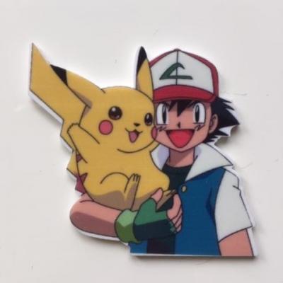 45*50mm  cabochon   en résine  pikachu pokemon dresseur